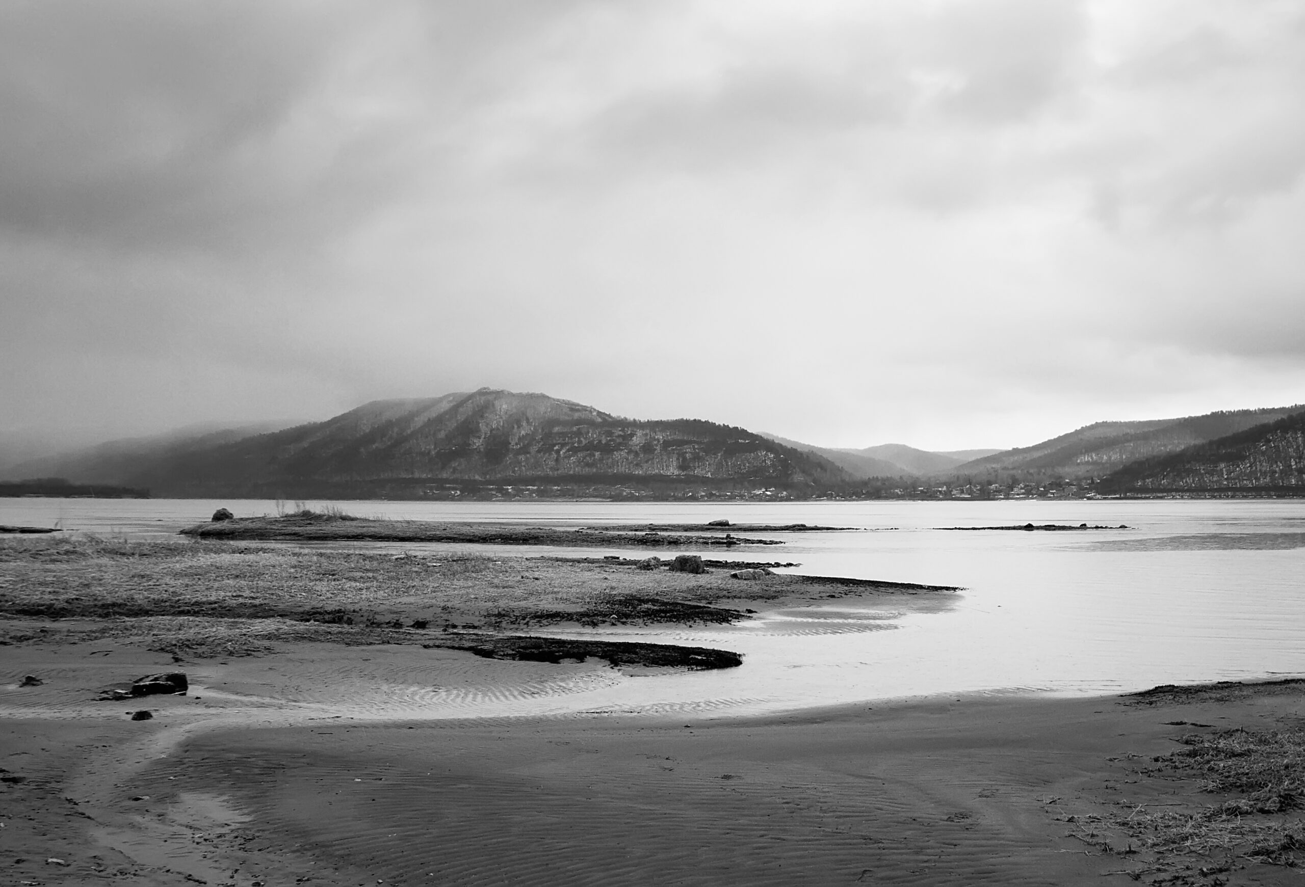 Overcast landscape. River and mountans.